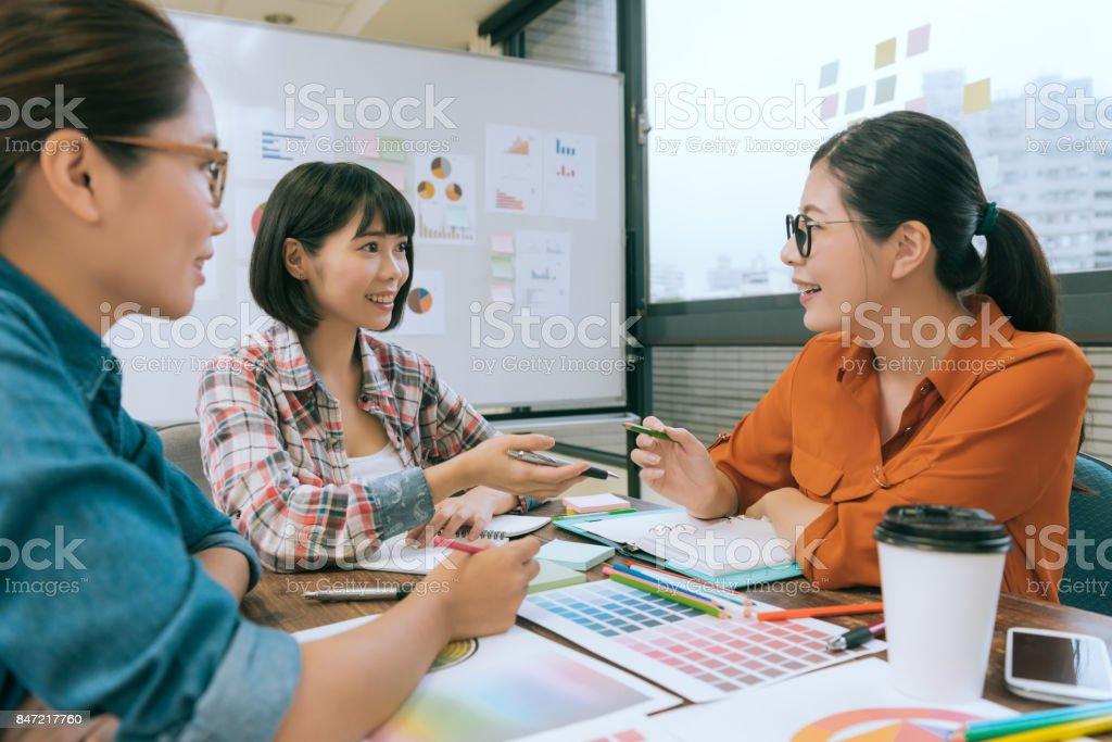 professional pretty women office worker talking stock photo