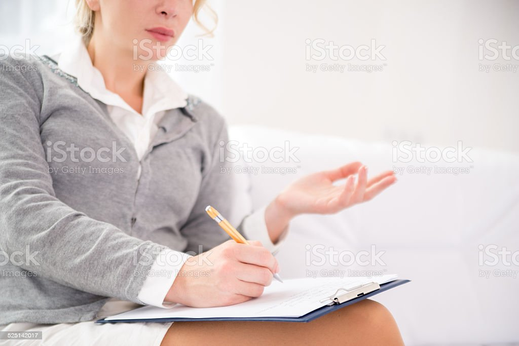 Professional psychiatrist during therapy session stock photo