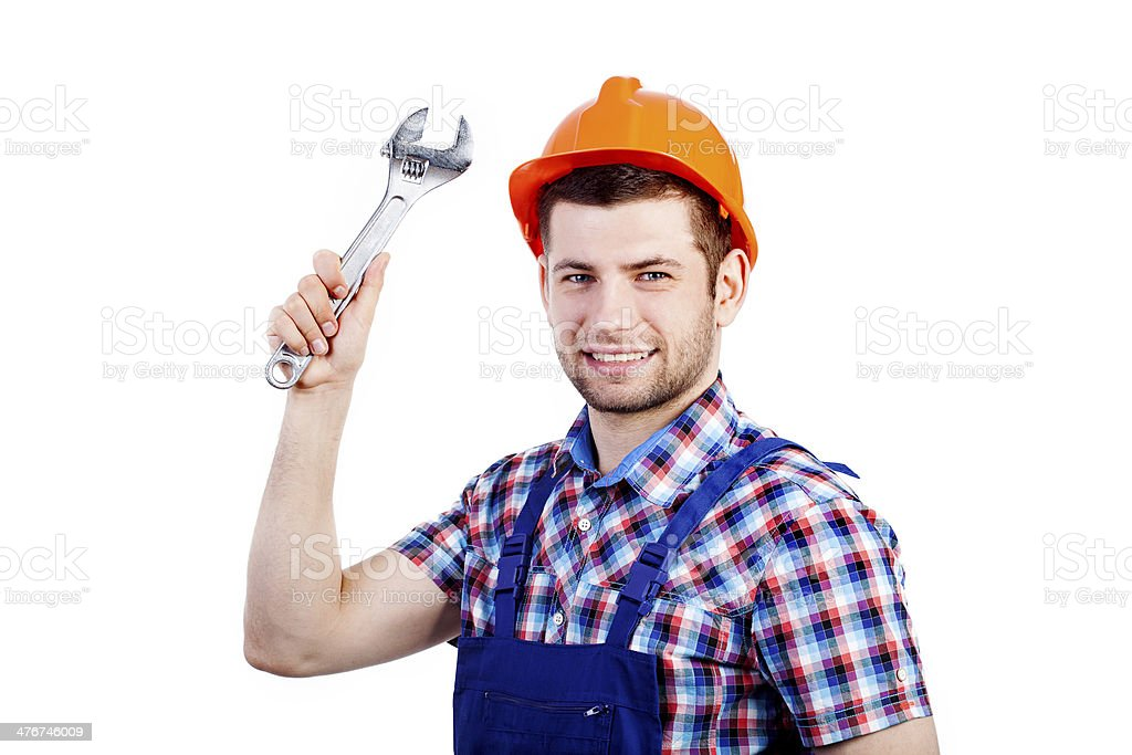 Professional repairman with wrench royalty-free stock photo