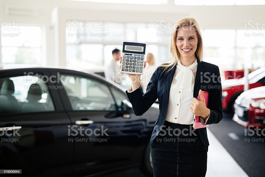 Professional salesperson in car dealership stock photo