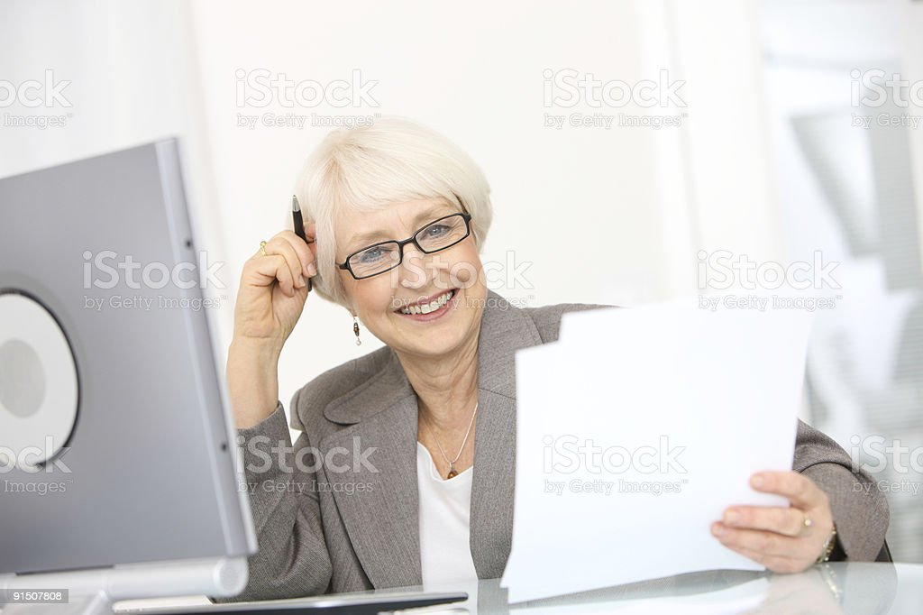 Professional senior businesswoman with papers royalty-free stock photo