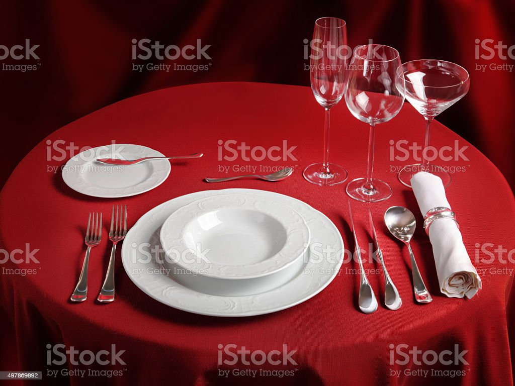 Professional setting of red dinner table stock photo