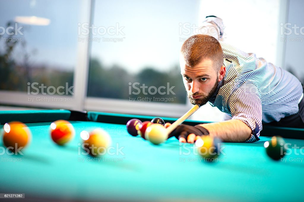 Professional snooker player aiming balls stock photo