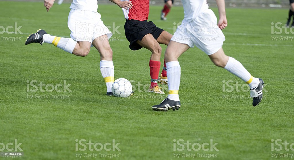 Professional soccer players in the middle of a football match royalty-free stock photo