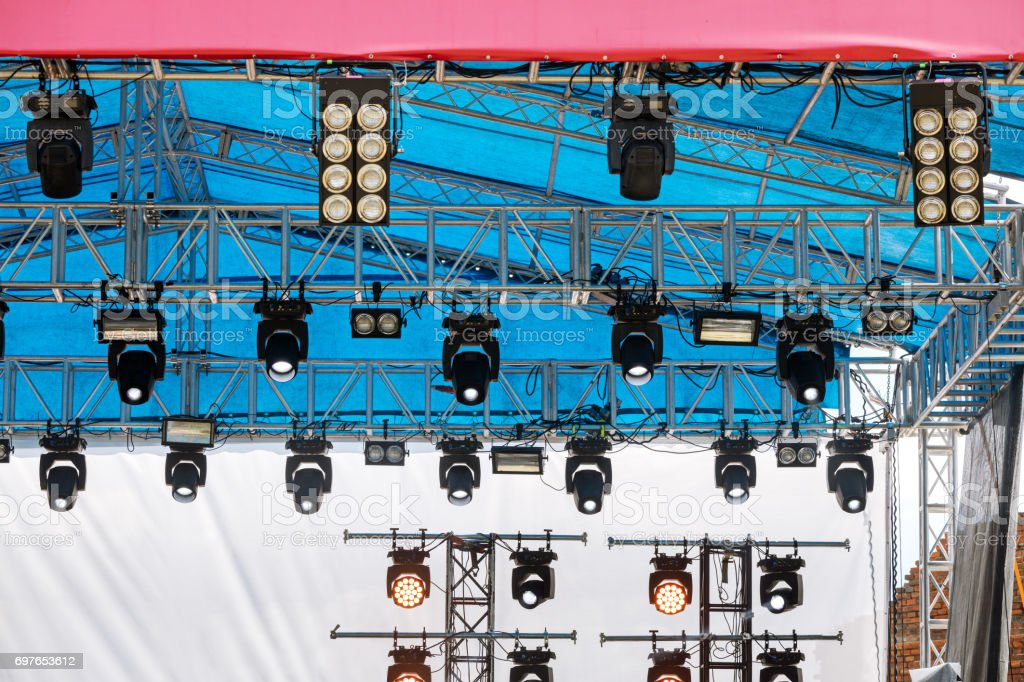 professional spotlight system mounted under roof of outdoor stage