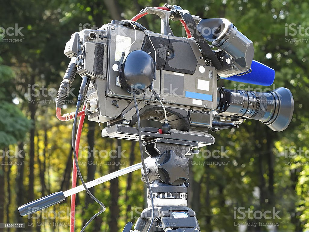 TV Professional studio digital video camera on tripod royalty-free stock photo