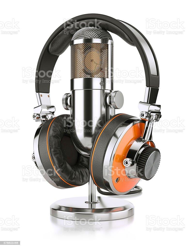 Professional studio microphone and headphones stock photo