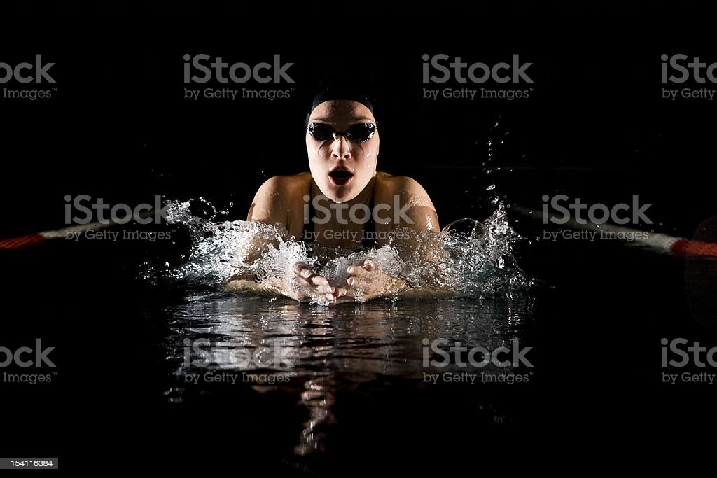 Professional swimmer breaststroke isolated black background royalty-free stock photo