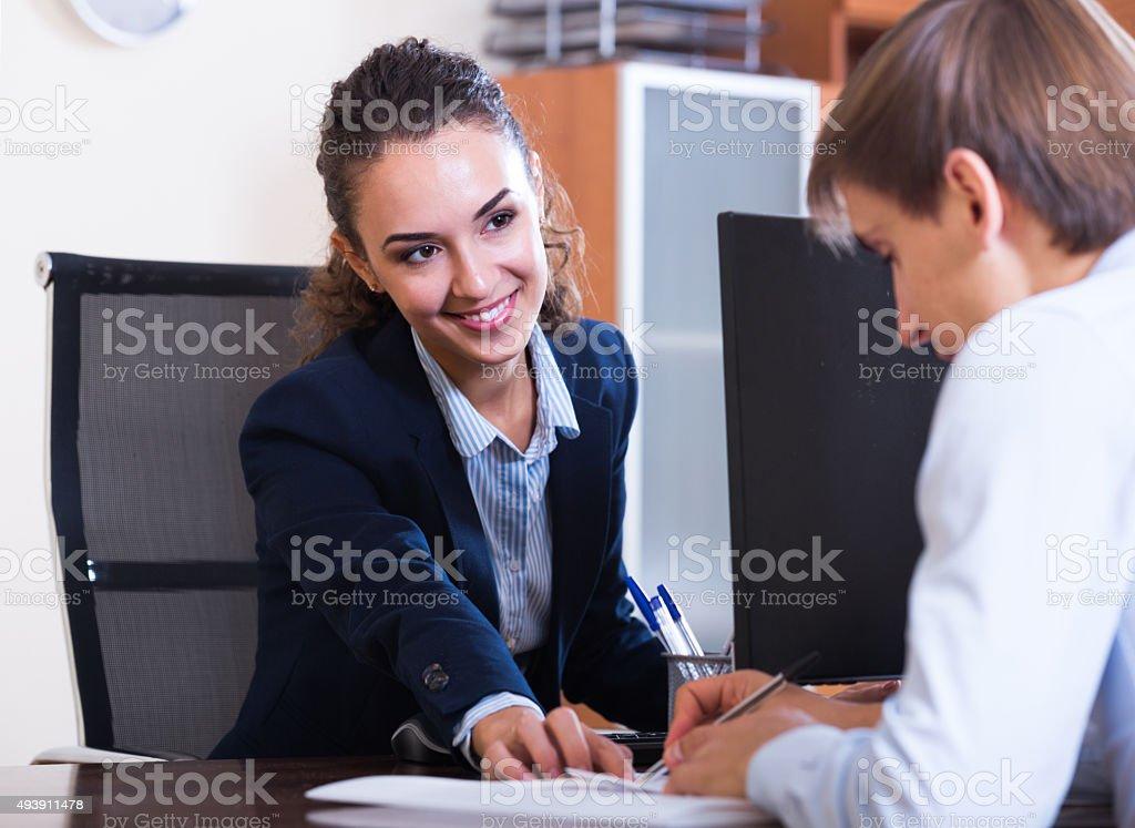professional teaching new employee stock photo