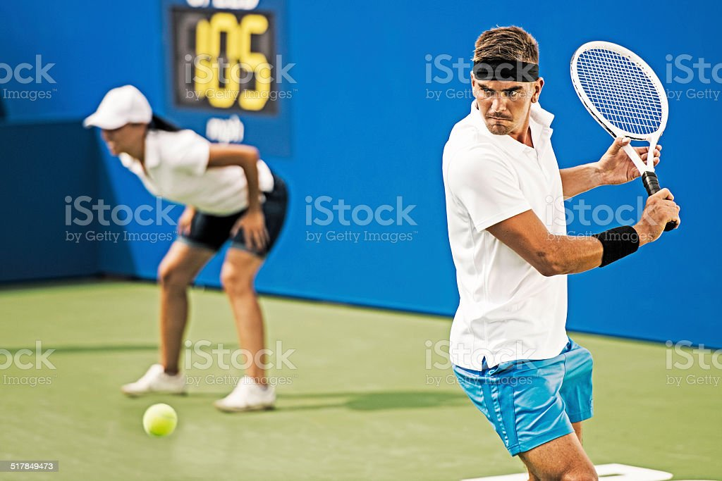 Professional Tennis Player Hit a Backhand stock photo