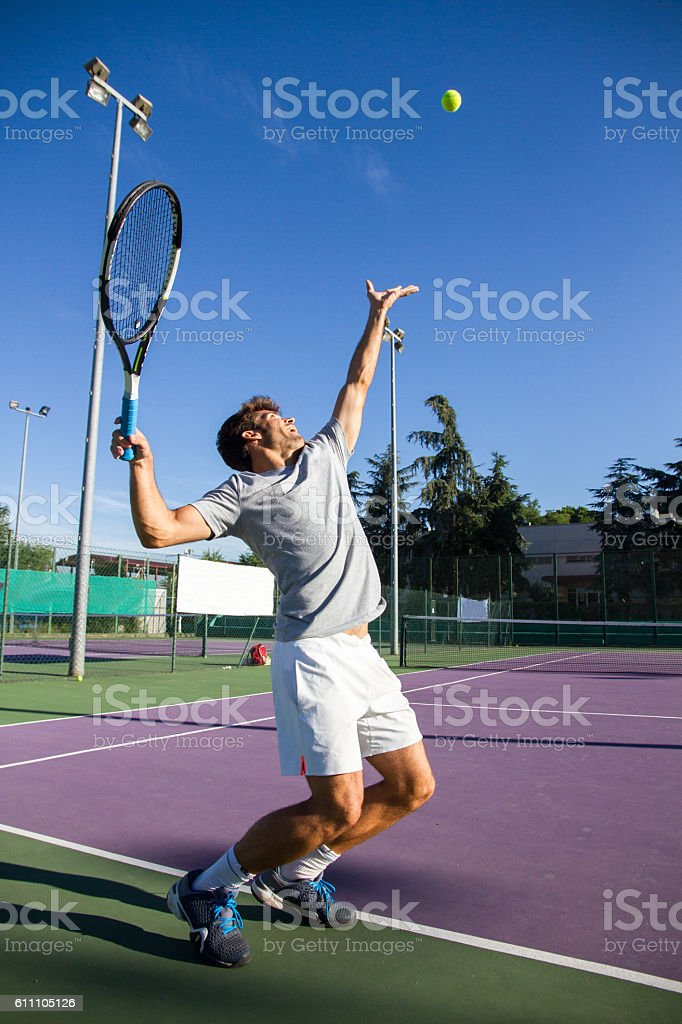 Professional tennis player is doing a kick tennis. stock photo