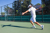 Professional tennis player is doing a kick tennis.