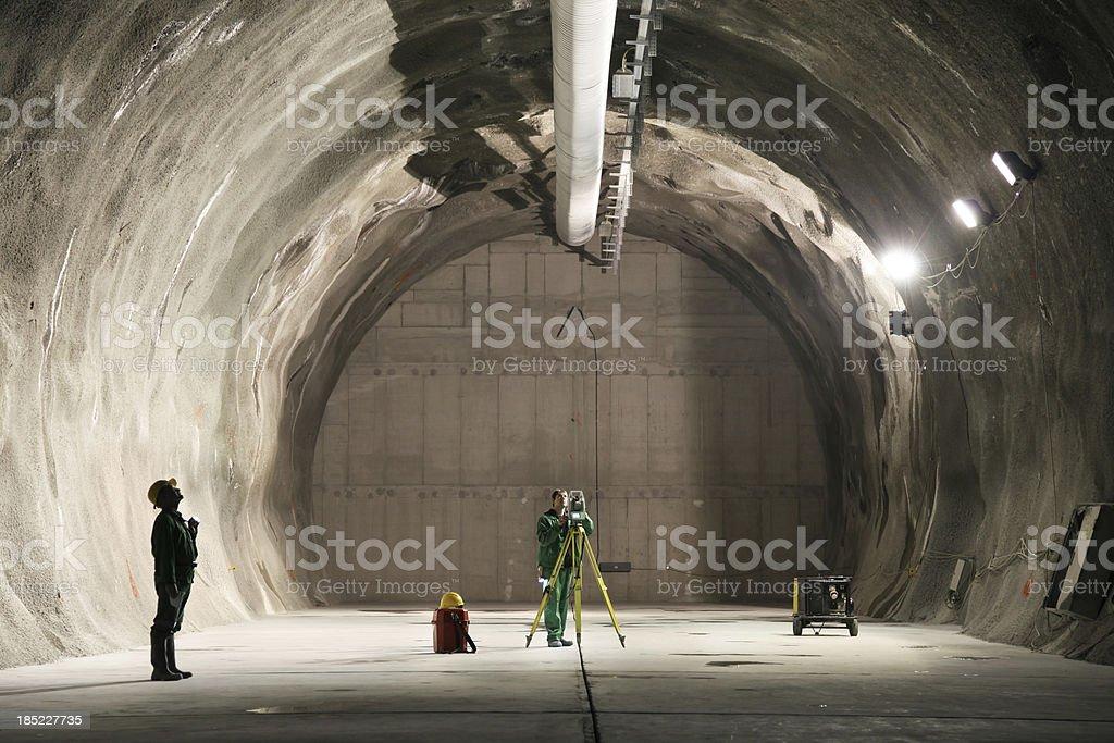 Professional underground workers stock photo