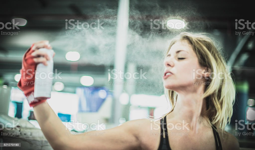 MMA Professional using refreshing facial spray after a boxing match stock photo