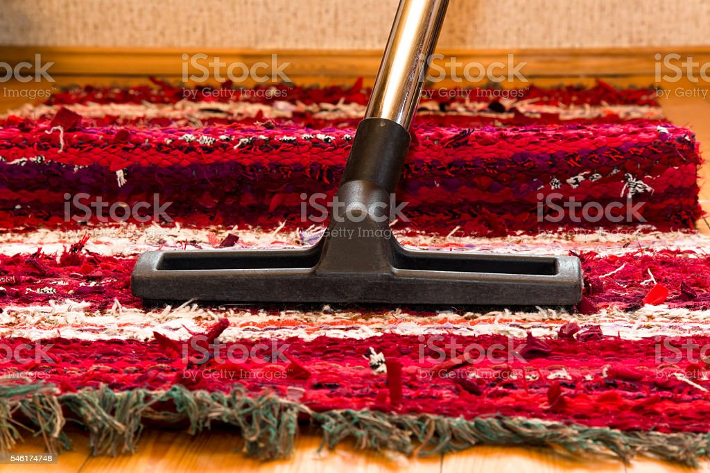 Professional vacuum cleaner brush frees the carpet from dust stock photo