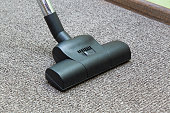 Professional vacuum cleaner turbo brush frees the carpet from dust.