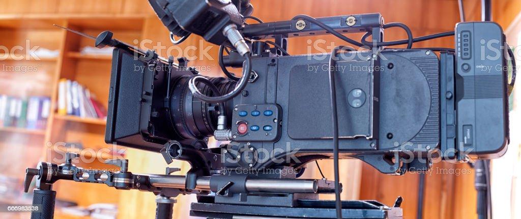 A professional video camera. stock photo