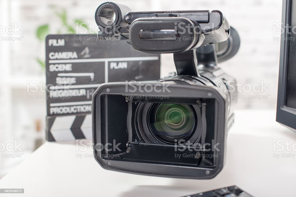 Professional video camera with a clapperboard stock photo