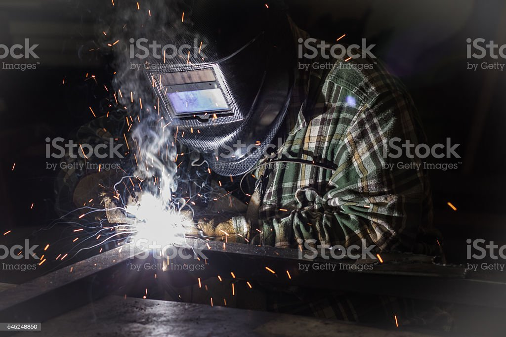 Professional welder at work stock photo