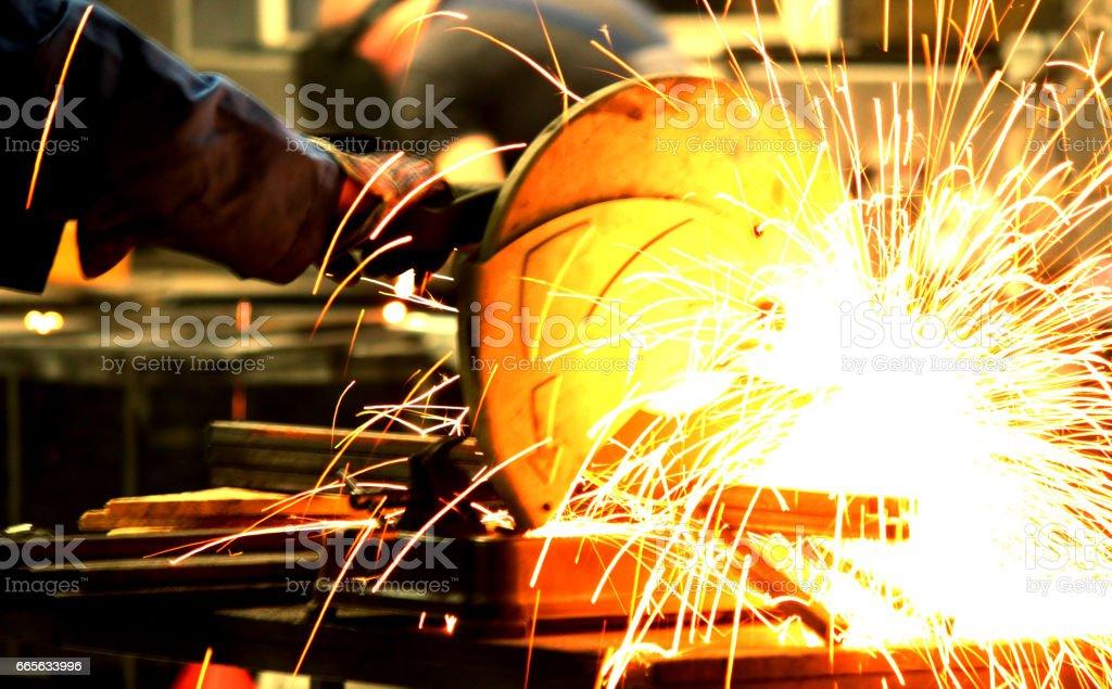Professional welder in a factory welding