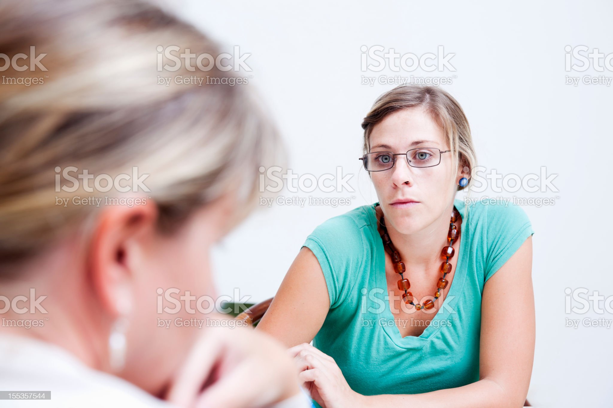 Professional with a client royalty-free stock photo