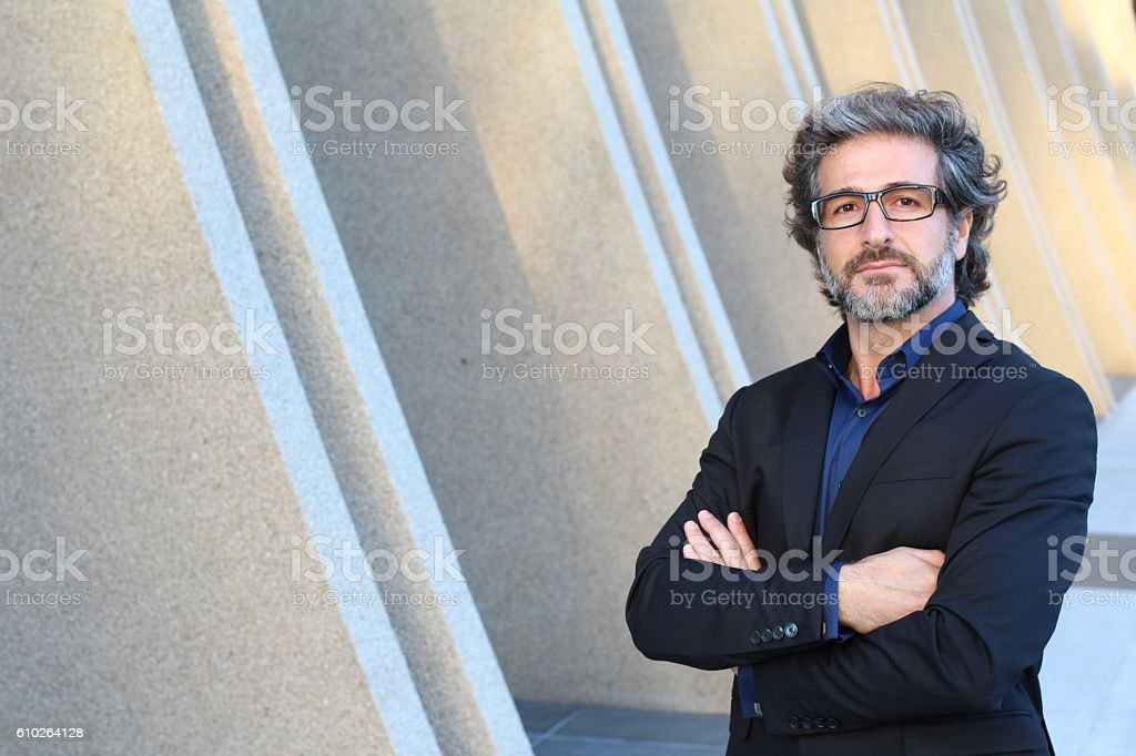 Professional with his arms proudly crossed stock photo
