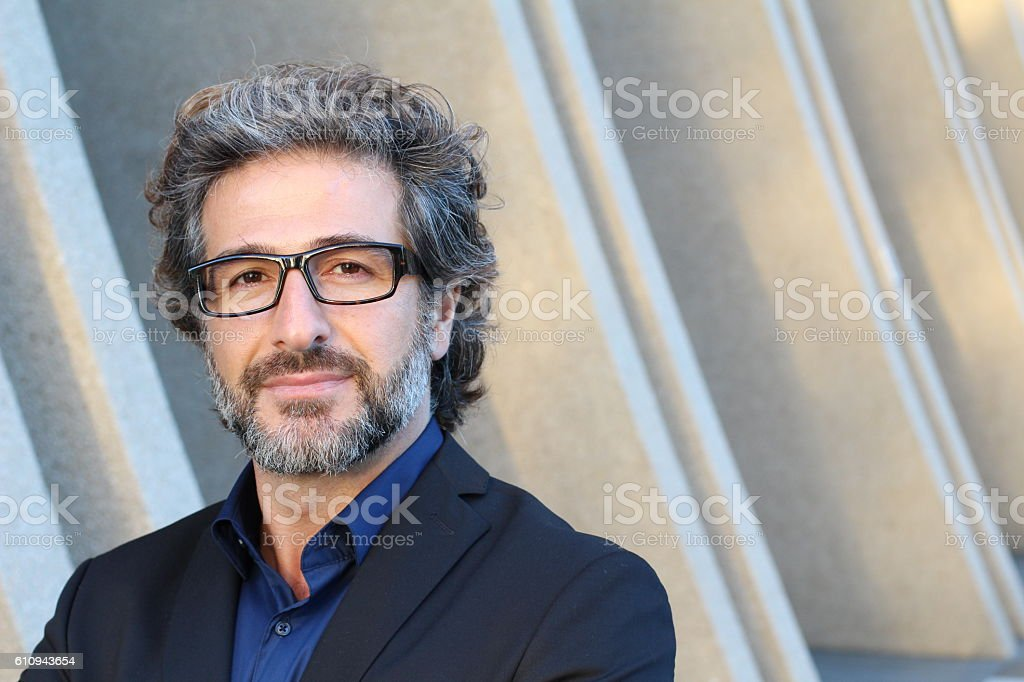 Professional with specs outside the office stock photo