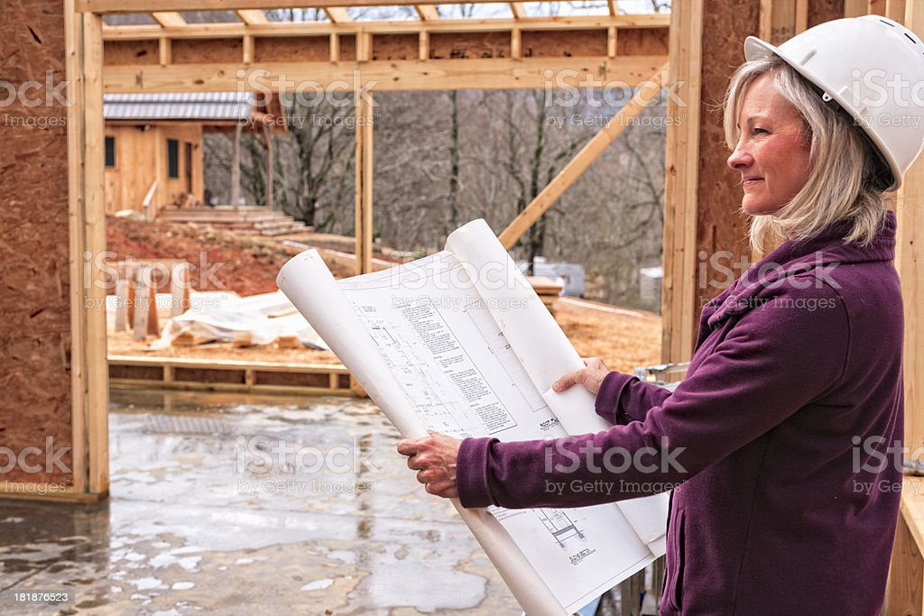 Professional woman architect, contractor, homeowner at construction site royalty-free stock photo
