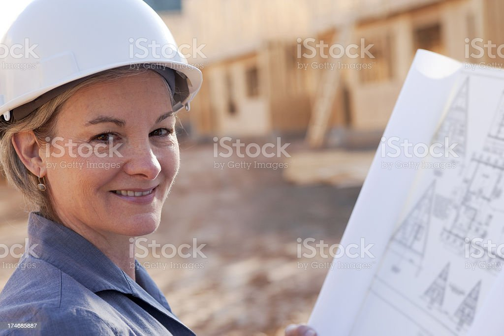 Professional woman at construction site (XXL) royalty-free stock photo