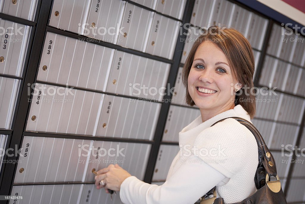 Professional woman checks the mailbox (XXL) royalty-free stock photo