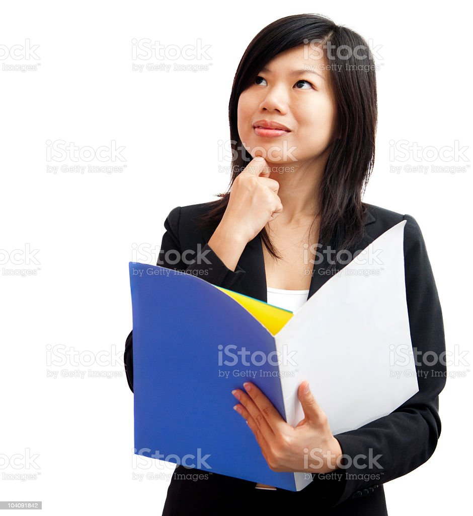 A professional woman holding a folder thinking royalty-free stock photo
