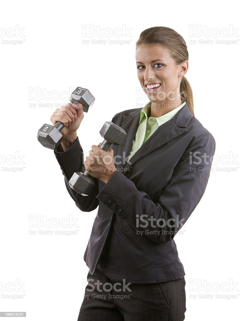 Professional woman holding two dumbbells royalty-free stock photo