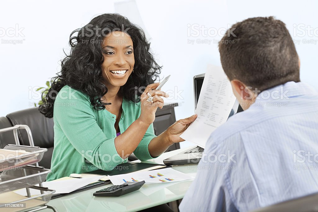 Professional woman speaking with colleague or client royalty-free stock photo