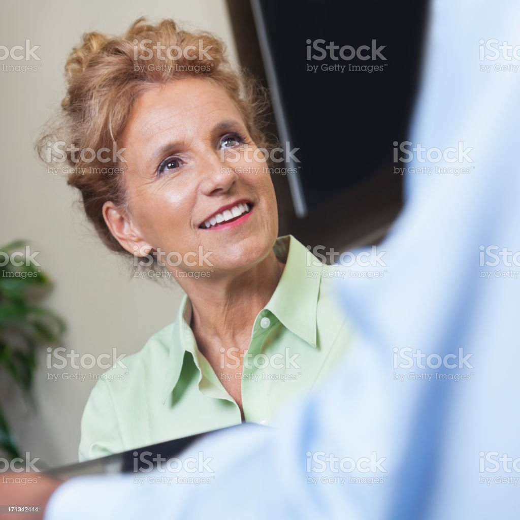 Professional woman talking with a man royalty-free stock photo