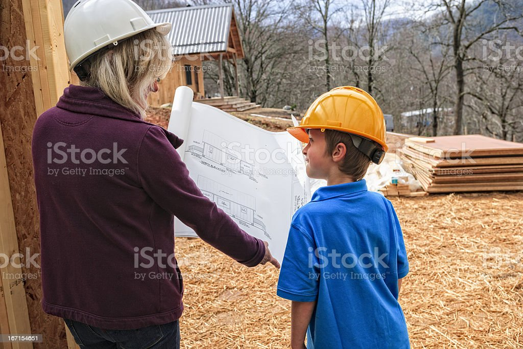 Professional woman with child at construction site royalty-free stock photo