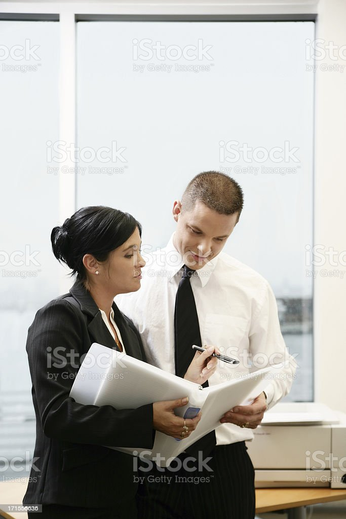 Professional workers looking at a document royalty-free stock photo