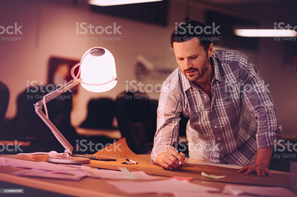 Professional working on his project stock photo