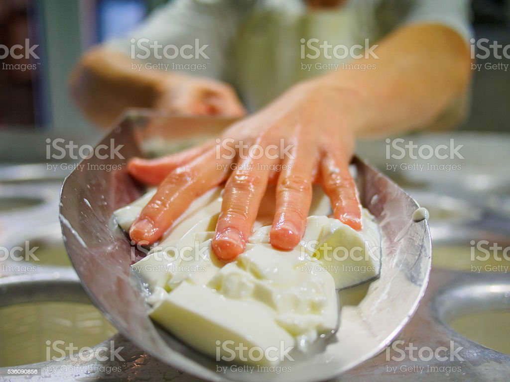 Professional working with curd cheese with hands stock photo