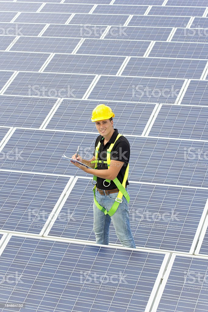 Professional working with solar panels royalty-free stock photo