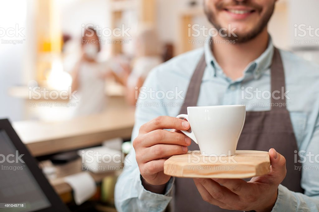 Professional young barista is working in cafe stock photo