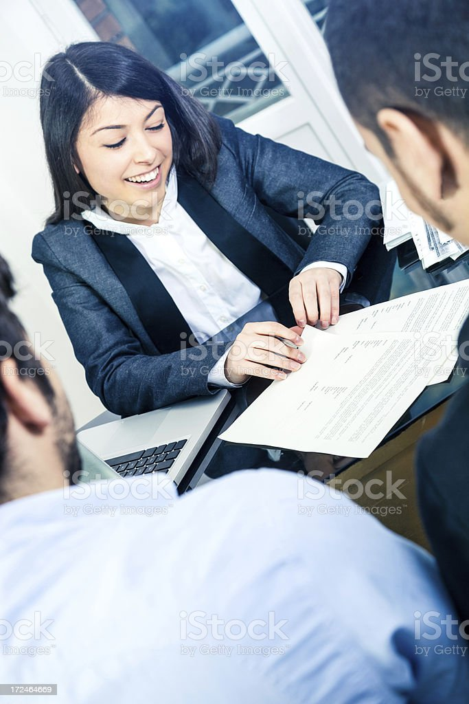 Professional young lawyer explaining to customers stock photo