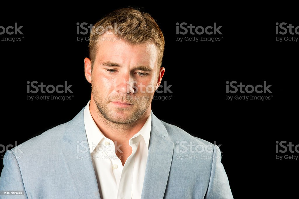 Professional Young Male Looking Down stock photo