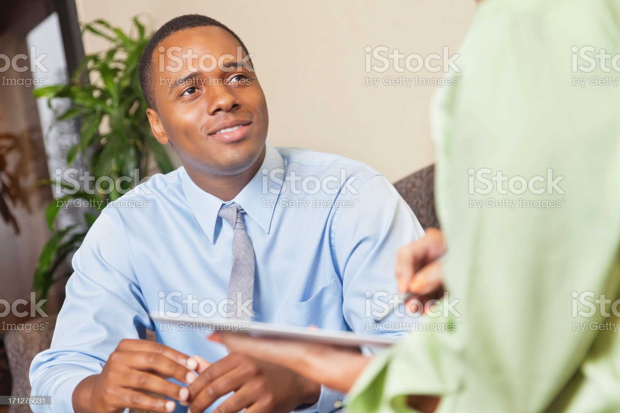 Professional young man in business meeting or counseling session royalty-free stock photo