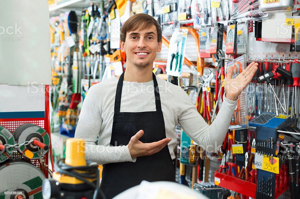 Professional young positive salesman working and smiling stock photo