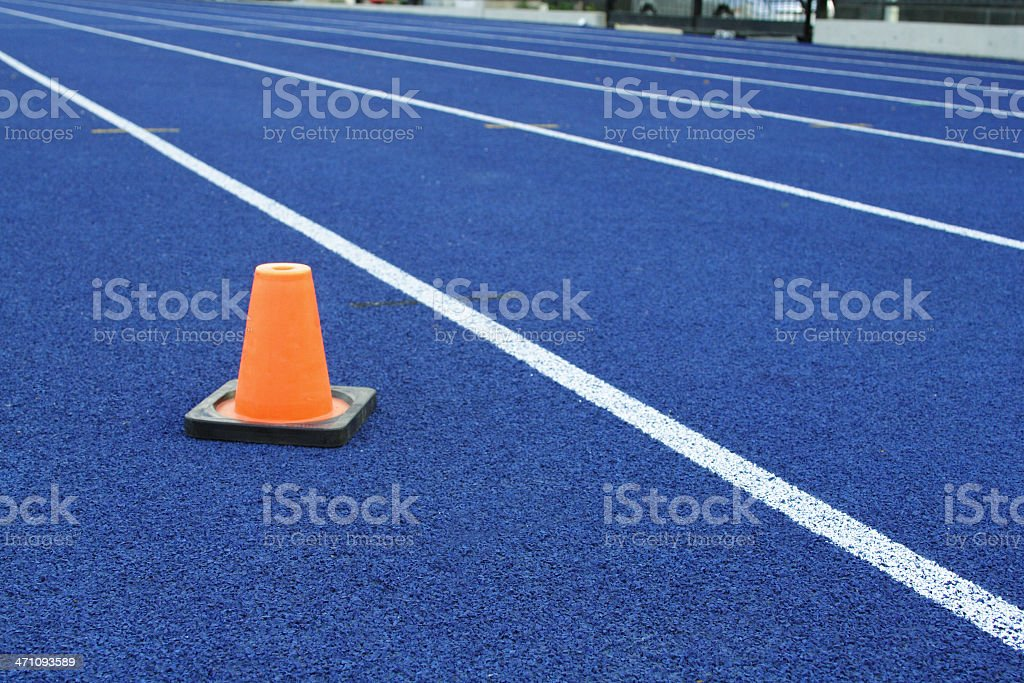 Professional-Grade Running Track with Orange Pylon royalty-free stock photo