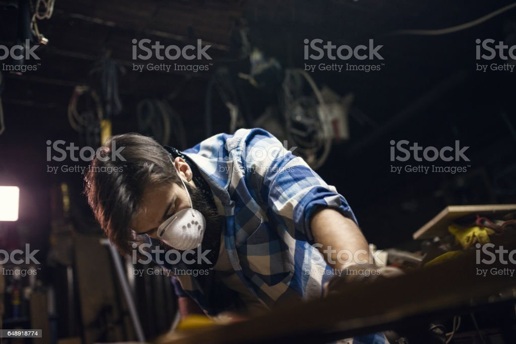 Professionally dressed carpenter in his workshop stock photo