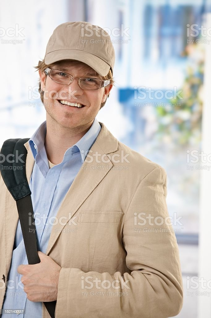 Professionally dressed man with a bag a wearing beige cap royalty-free stock photo