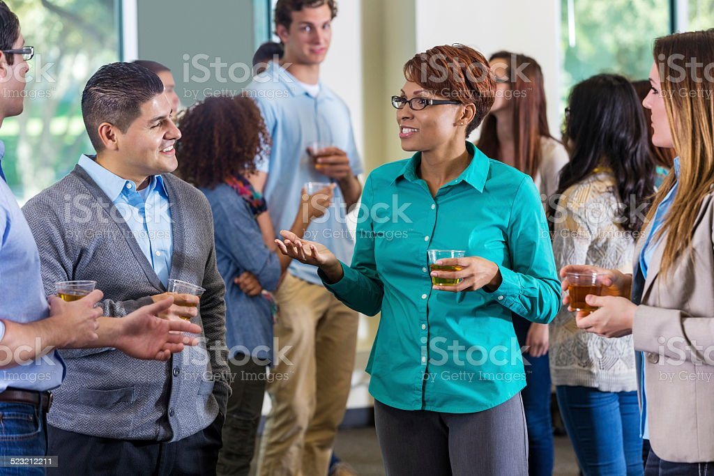 Professionals and alumni talking during mixer or party stock photo