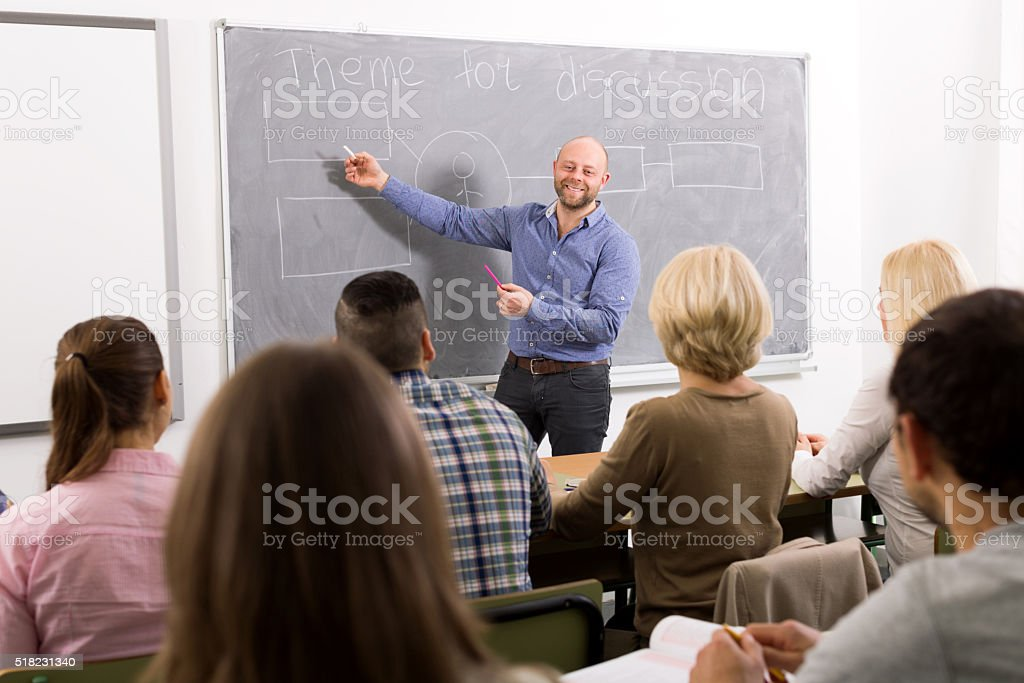 Professionals and coach at training stock photo