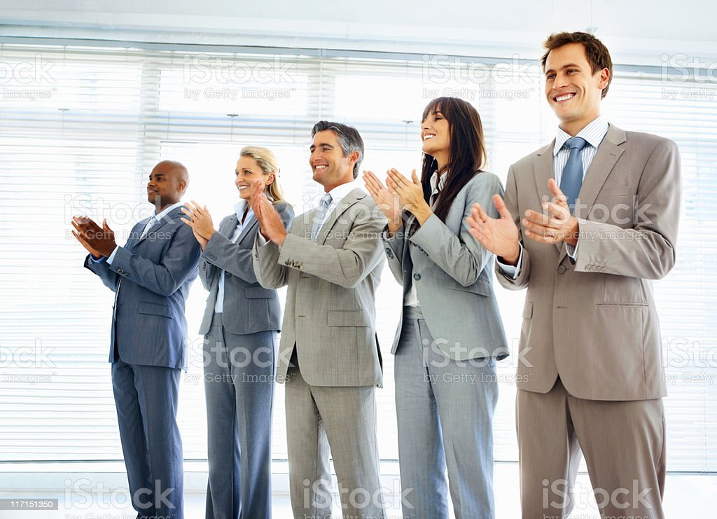 Professionals applauding during a business meeting royalty-free stock photo